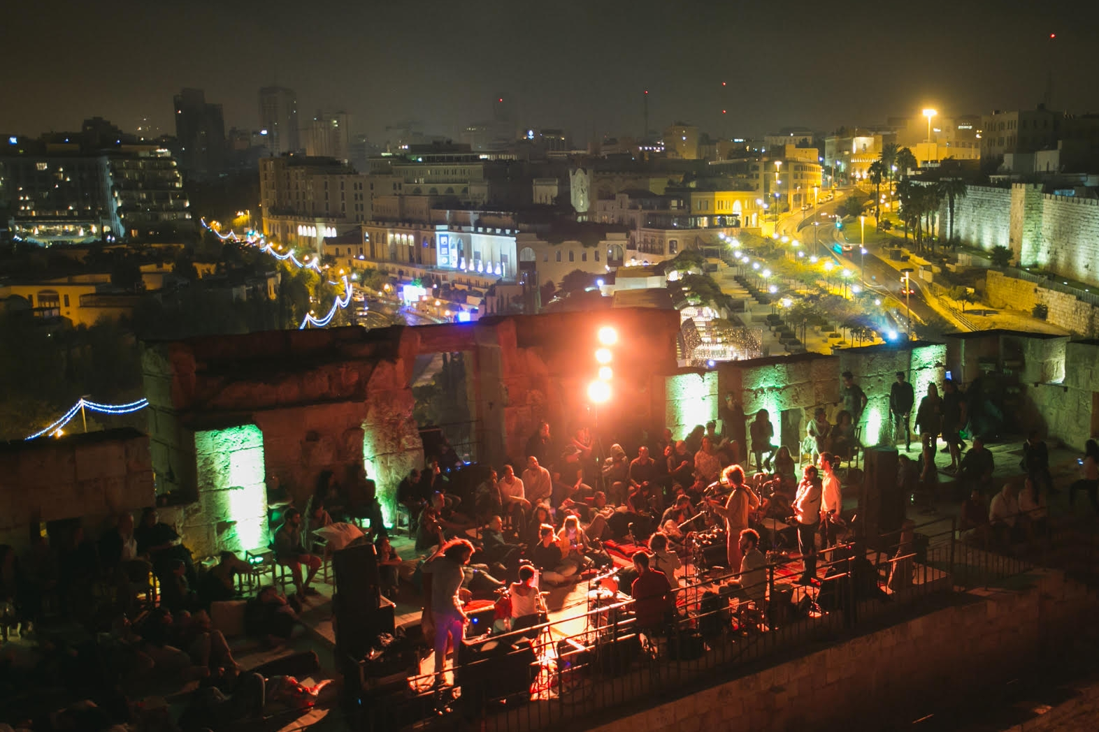 Rooftop performance at the Mekudeshet Festival with downtown Jerusalem in the background