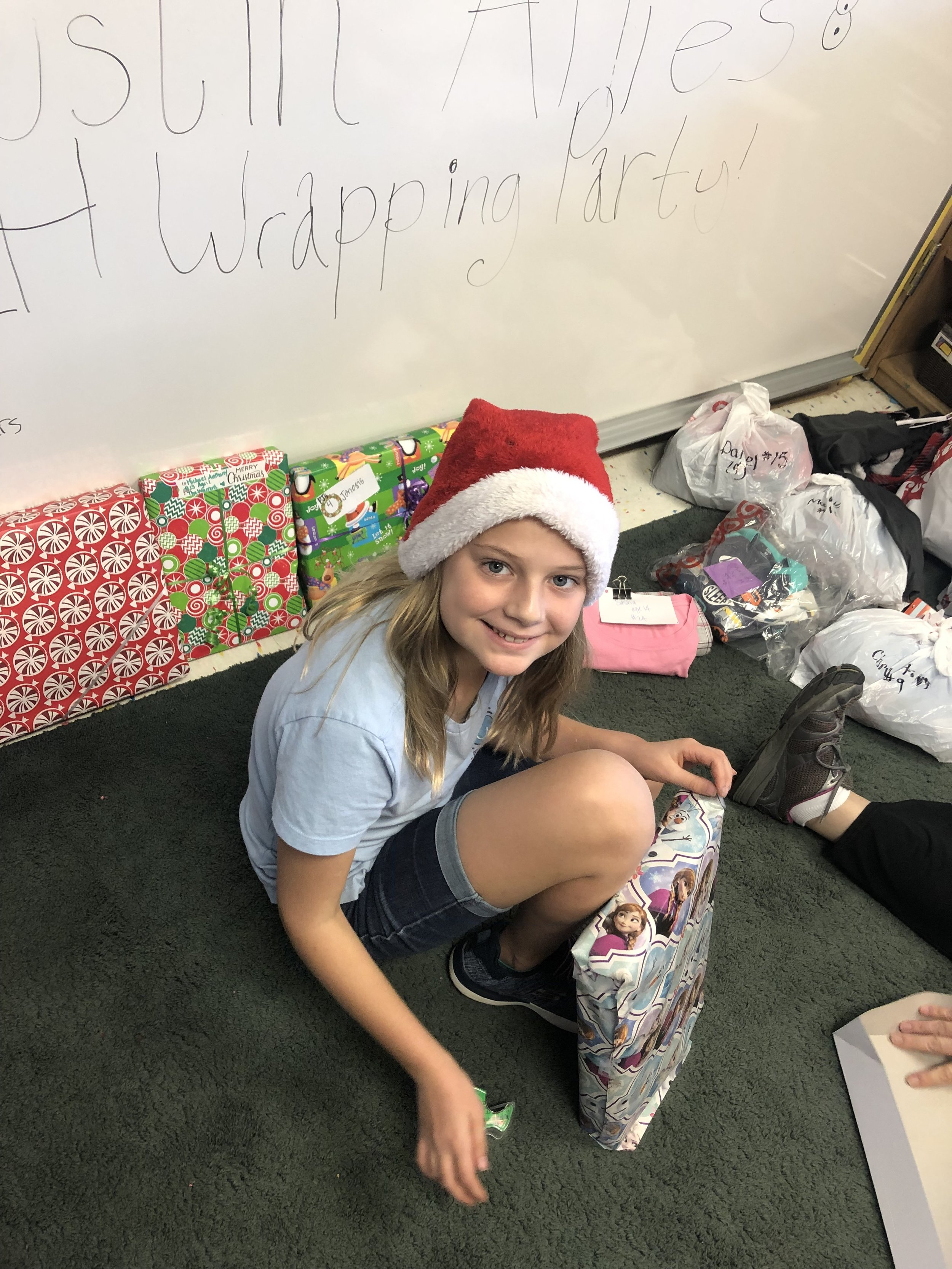 Ellie wrapping pajamas for the families at Saint Louise House.