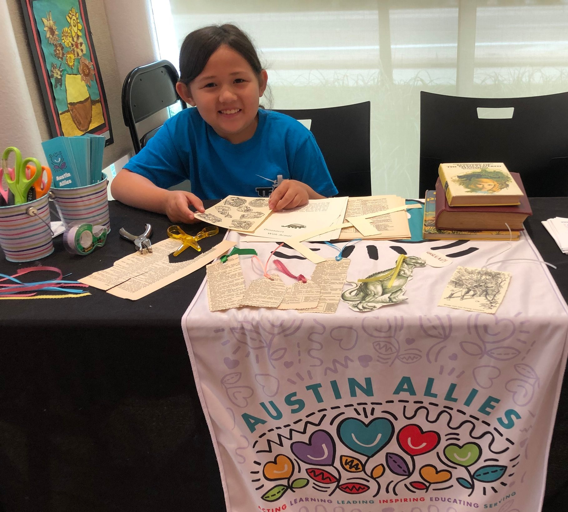 Kassie recently helped us run our booth at AISD's Summer Reading Splash!