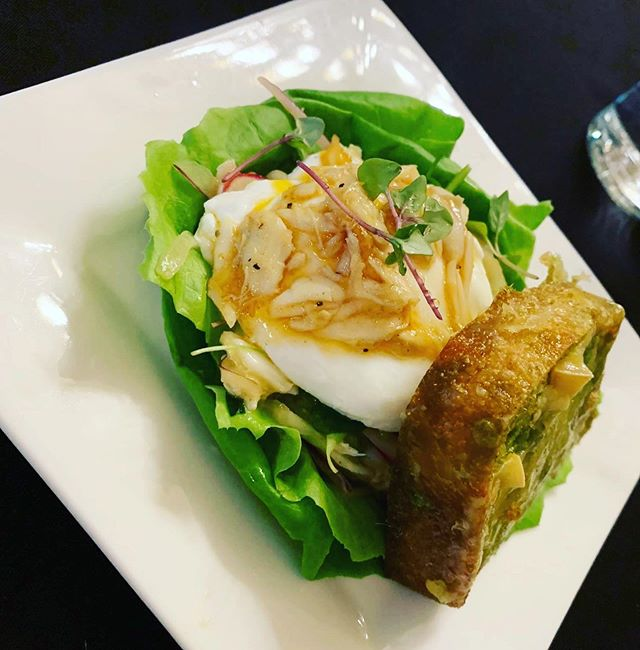 North Carolina Crab Salad - warm NC crab served over local butter lettuce, radish, poached egg.  Fennel, pea shoots, Grayson cheese with a brown butter vinaigrette.