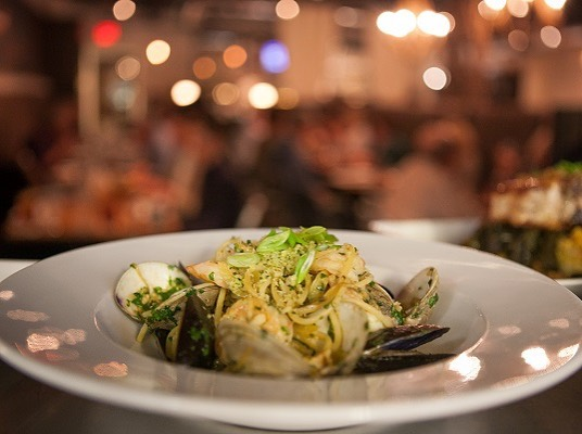 Seafood bagna càuda pasta - NC shrimp and clams, PEI mussels, bagna càuda sauce, toasted herb butter breadcrumbs, leeks and scallions, white wine parmesan.