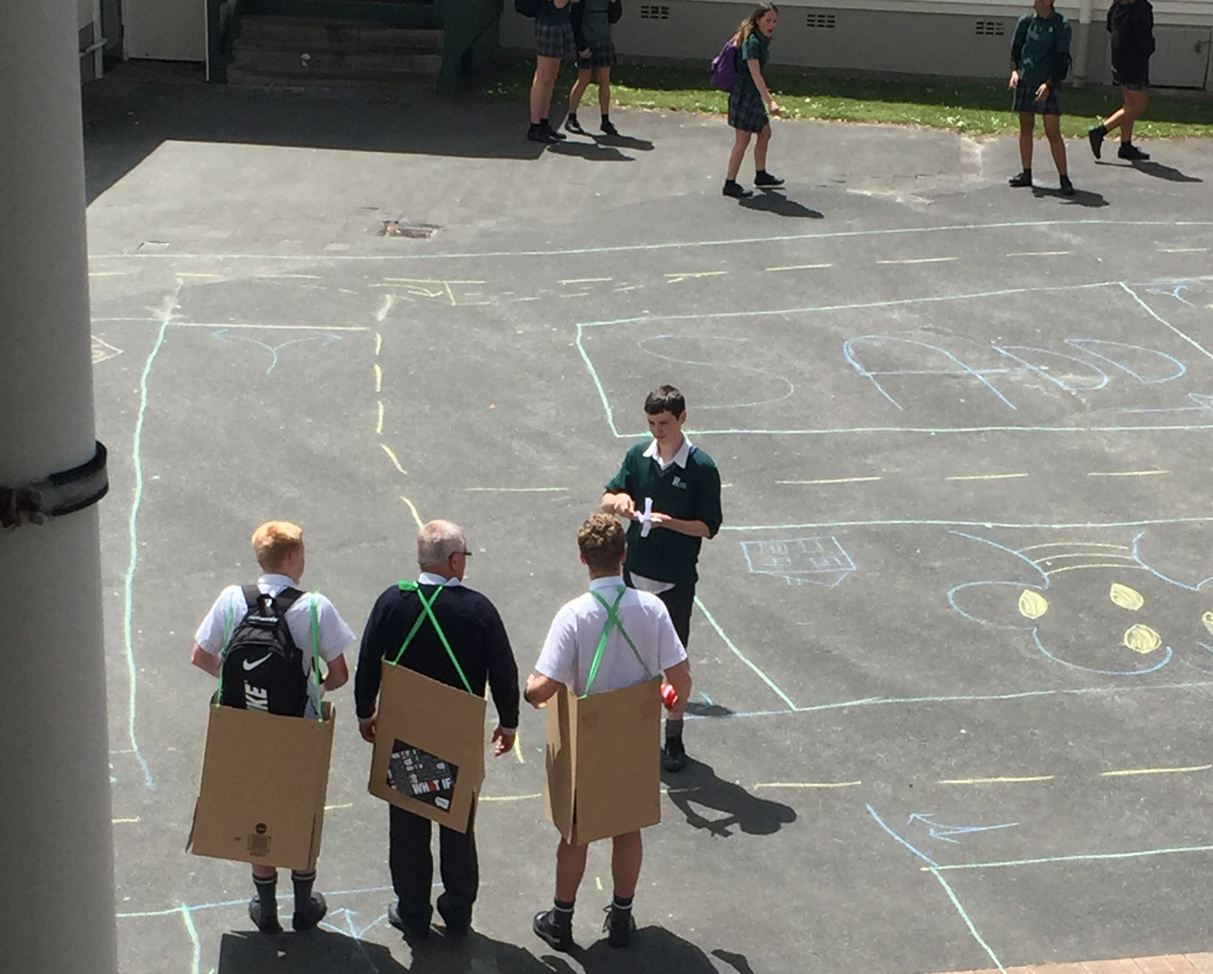 Students had to complete a chalk road course in cardboard cars to demonstrate their knowledge of the road rules