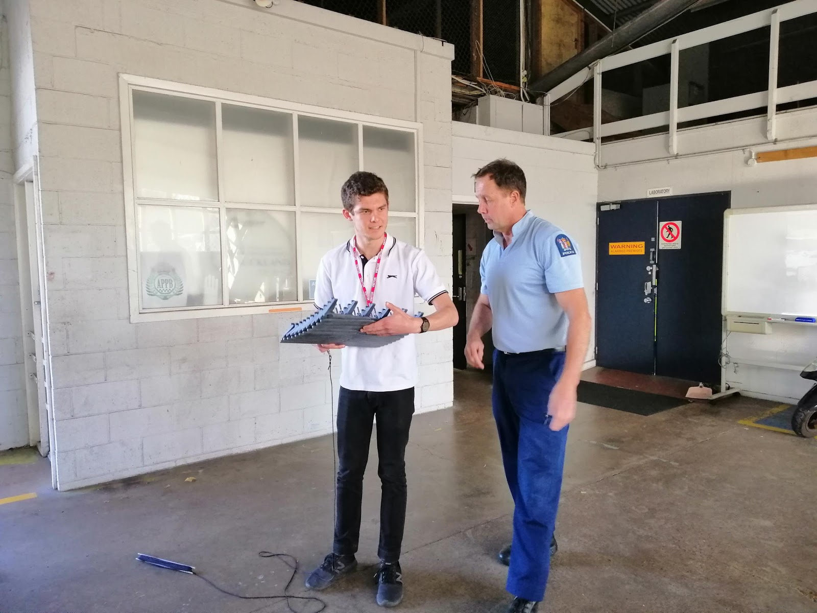 Snr Sergeant Rod Salt gives Dathan Barkhausen the run-down on laying  road spikes at Auckland's Harbour Bridge Police Station.