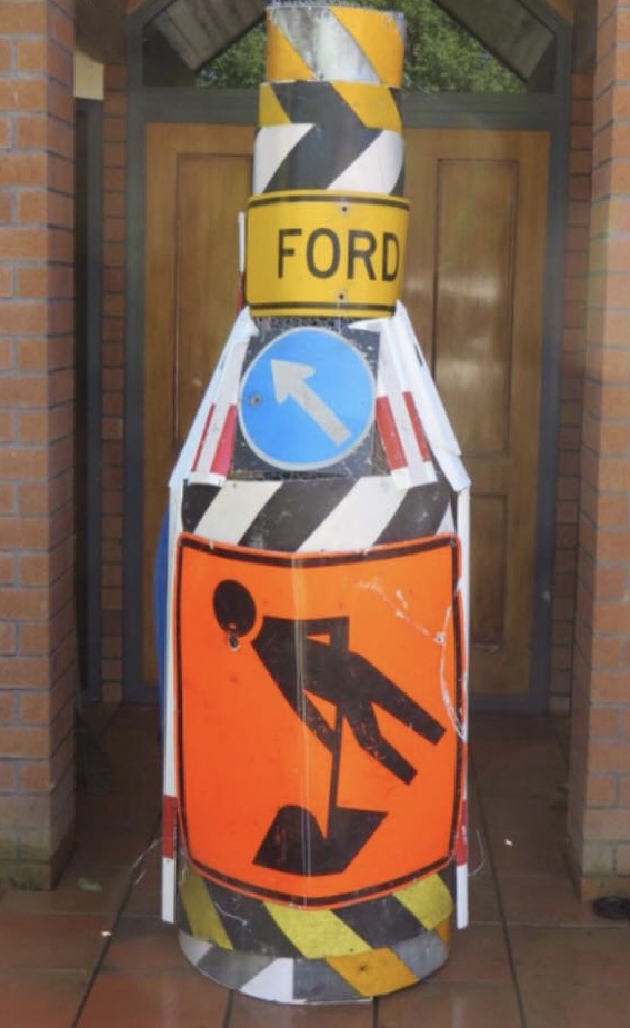 The final artwork created from the mangled local road signs