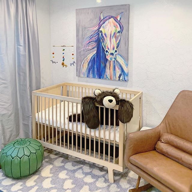 Here it is, our baby boy's room 🤗. The design of this space didn't take me long since I already had this horse art piece that I fell in love with years ago + I've just been waiting to incorporate it into our home when it felt right. The general space from the wallpaper to rug to furnishings are in neutral white + grey which allowed the fun accent pieces like the art, hanging mobile, ottoman pouf + children books to visually pop in the space. It's all about visual stimulation with color, animals + texture. . . . . . . . . . .  Project: Interior Design Client: Our Baby Boy's Room
