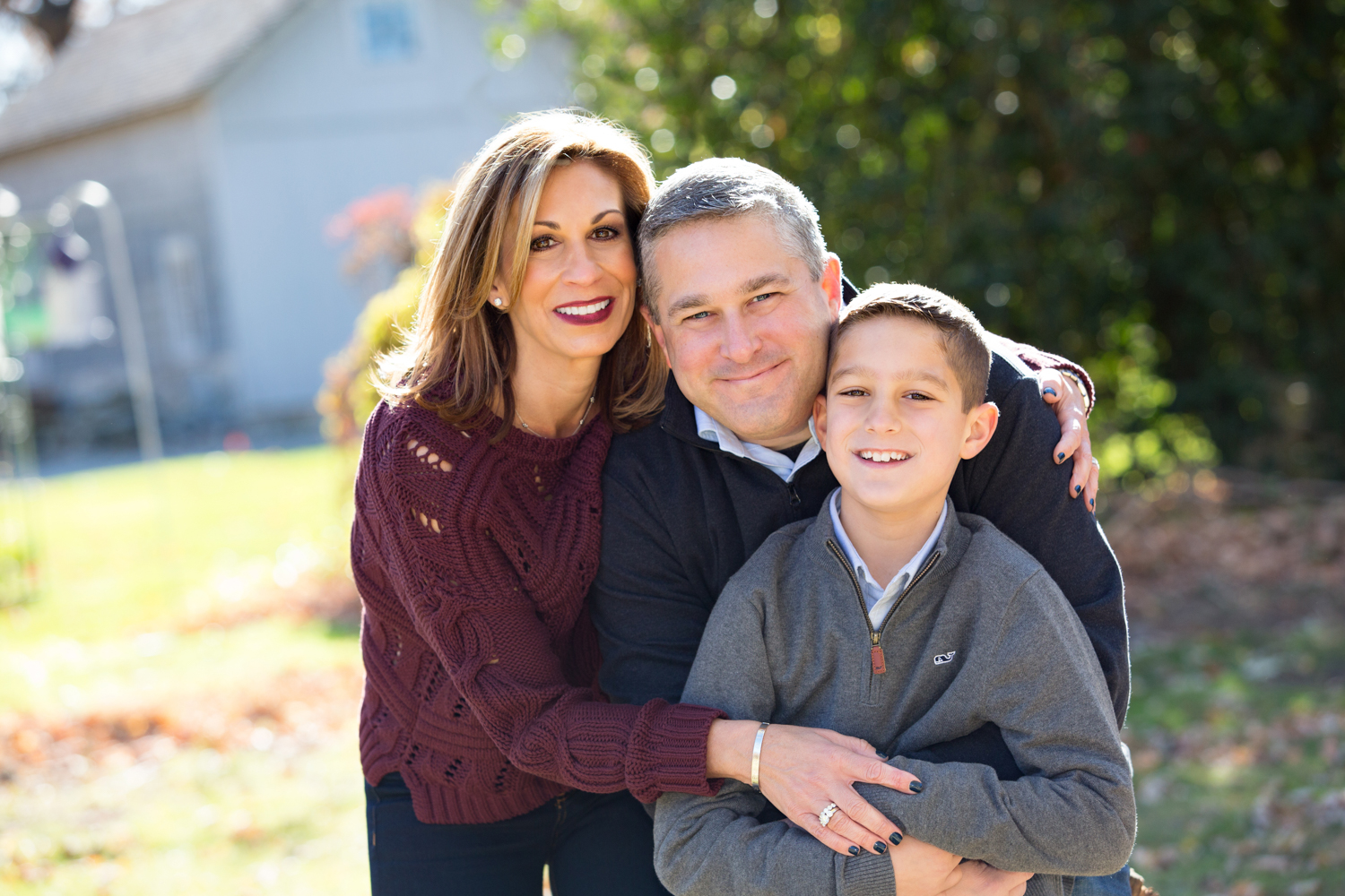 lLoving family enjoying their photography session at the Kissam House in Huntington NY
