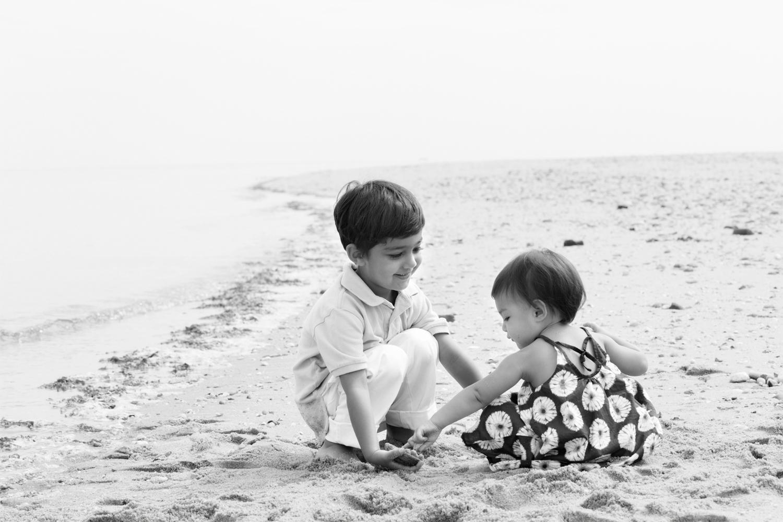 Brother and sister enjoying a morning at Crab Meadow Beach Long Island