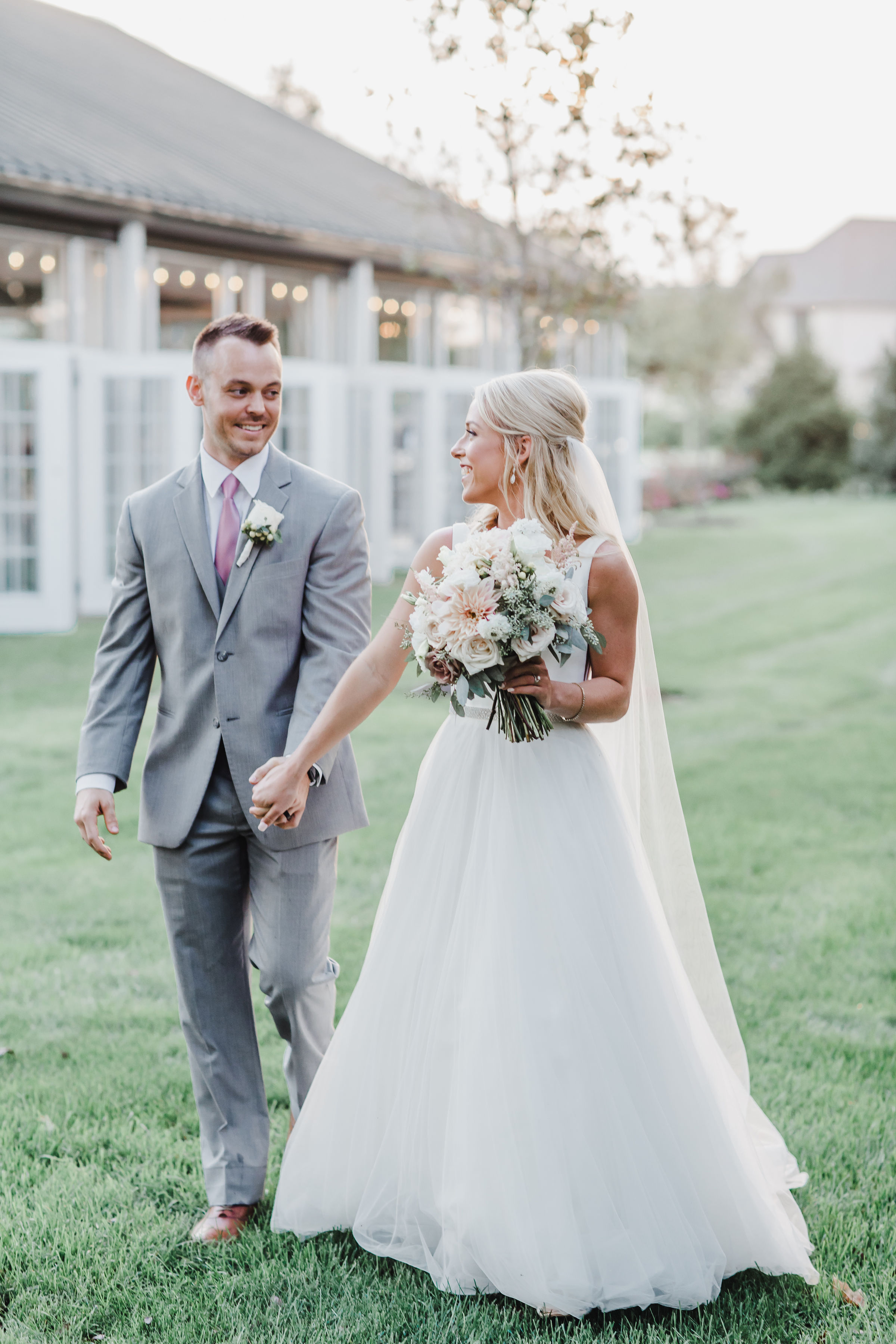 """""""Rachael captured our wedding day 10/5/18 and she did an AMAZING job! I really can't say enough good things about the entire process working with her. She was a complete joy to work with and made everyone feel so comfortable throughout the entire day of the wedding. Not only was she the best to work with, her work is amazing. I highly recommend having her for your big day, you will not be disappointed!"""" - - Tara and Taylor"""