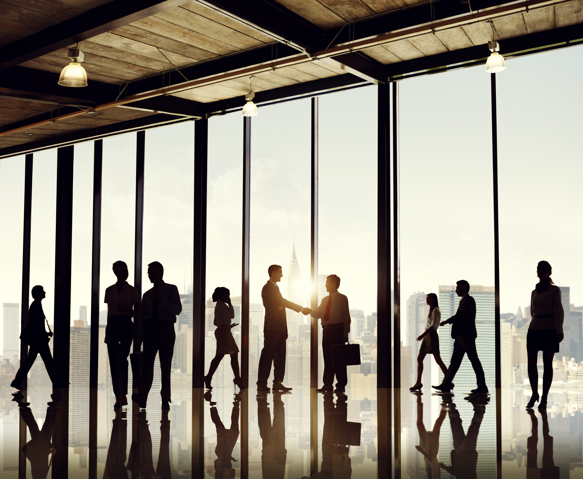 Yes, this is a stock photo. This image shows business people shaking hands, in a beautiful office, with gorgeous views. You have seen this somewhere, and it's a fantastic image. But should you use it in your company's marketing material ?  Photo by Rawpixel | Getty Images