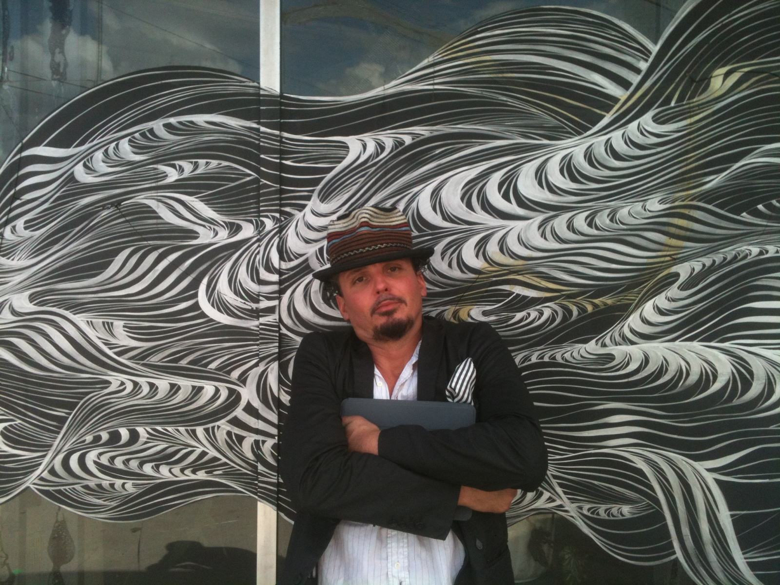 David Ellis in front of his  Smoke  mural at the former Rib Hut restaurant. | Photo credit: Meg Abernethy