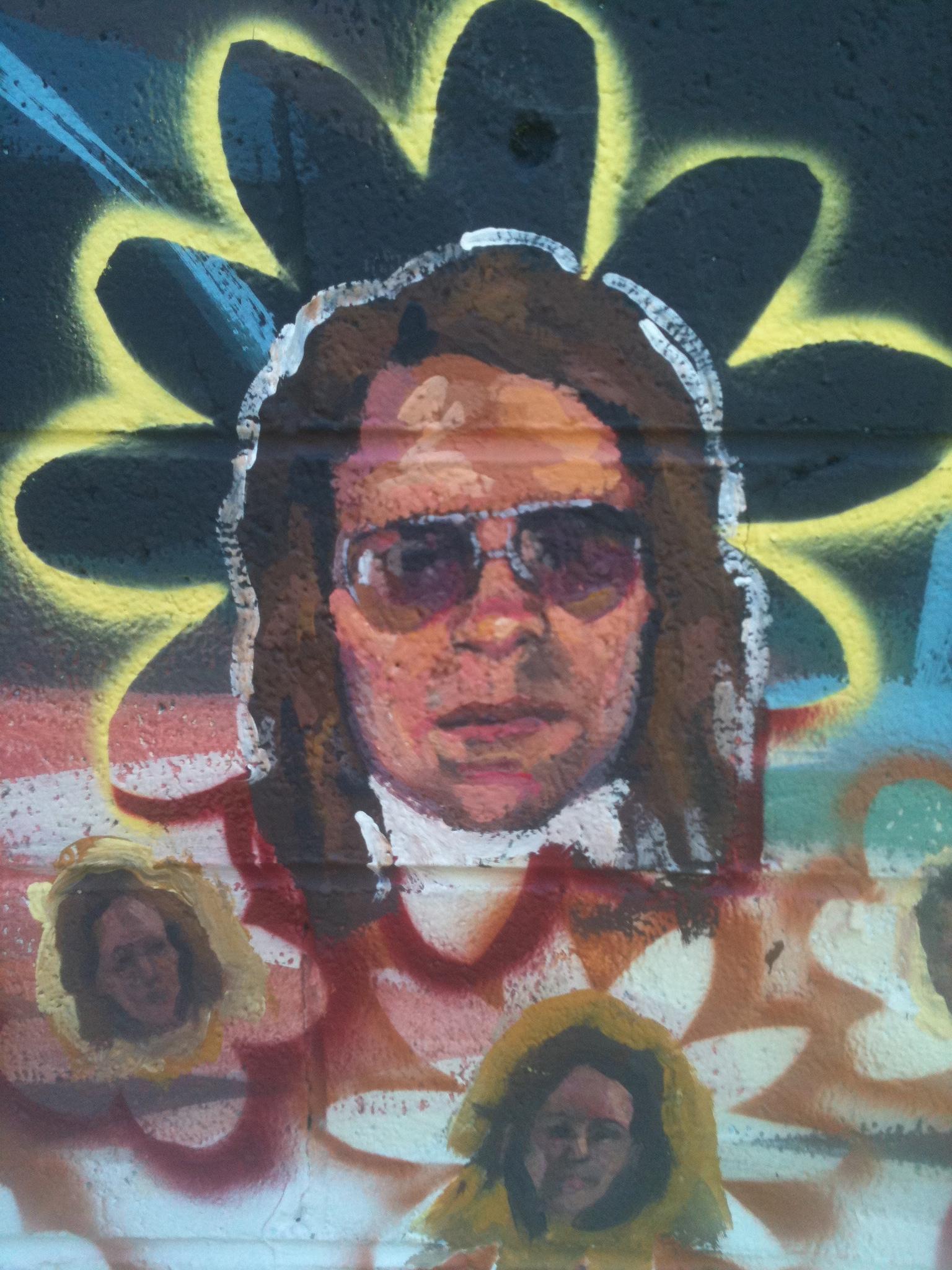 Mural detail L to R: portraits of Katherine Sandoz, Ben Maher, Lisa Parker Fort