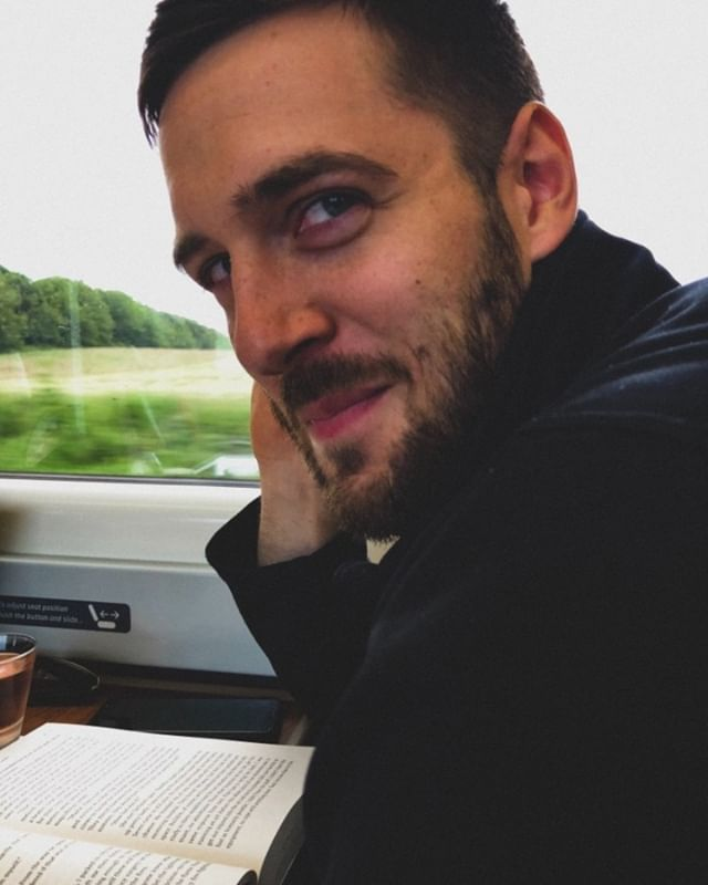 "the most handsome train buddy i've ever had — and the ""most annoyed with photos"" husband i've ever had."