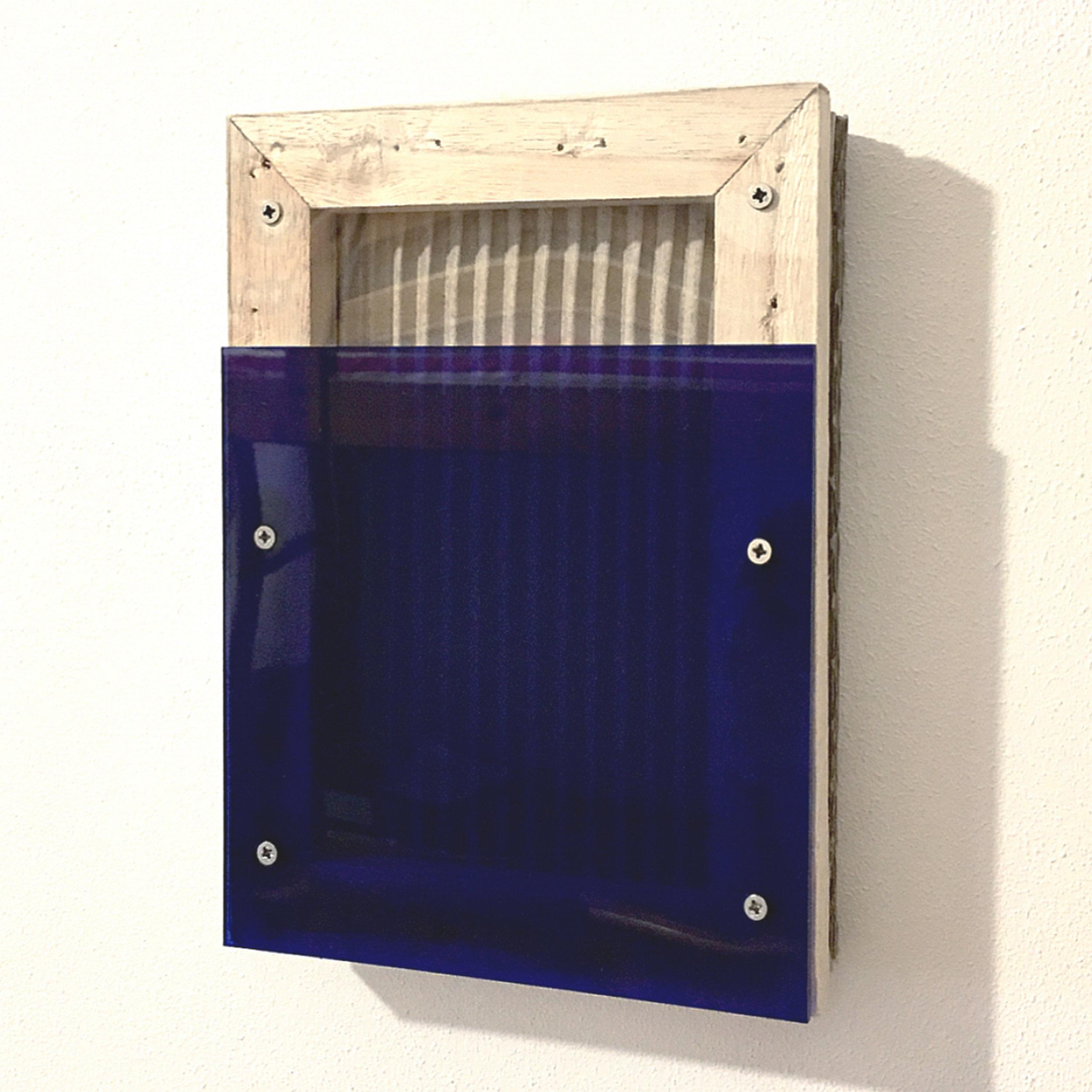 RAL 2.0  Cardboard, blue and transparent plexiglas, screws, on wooden canvas 8.27 x 5.90 x 1.38 inches 21 x 15 x 3.5 cm 2018