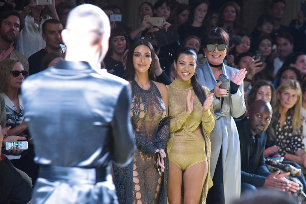 Keeping in with the Kardashians  Kim, Kourtney and Kris Jenner applaud the Spring 2017 show. MAIN IMAGE, TOP Olivier Rousteing accompanied by Julia Frauche, a model