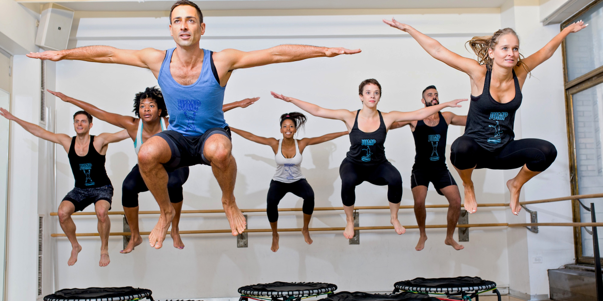 People taking a trampoline class at TrampoLEAN gym