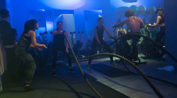 Fitness class under blue lights at Switch Playground