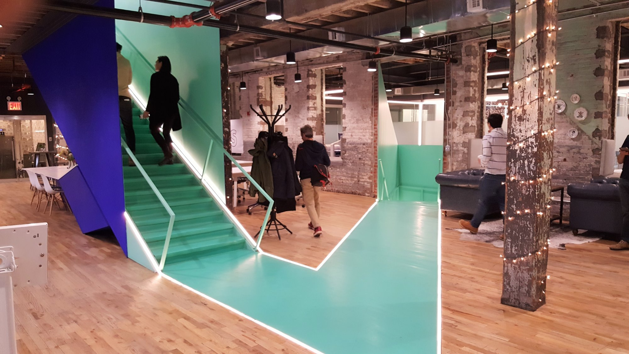 People walking upstairs at an open coworking space