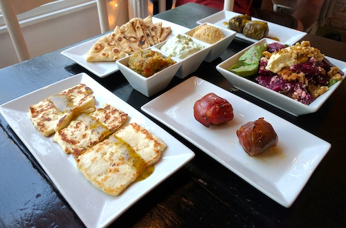 Variety of Greek food in white dishes