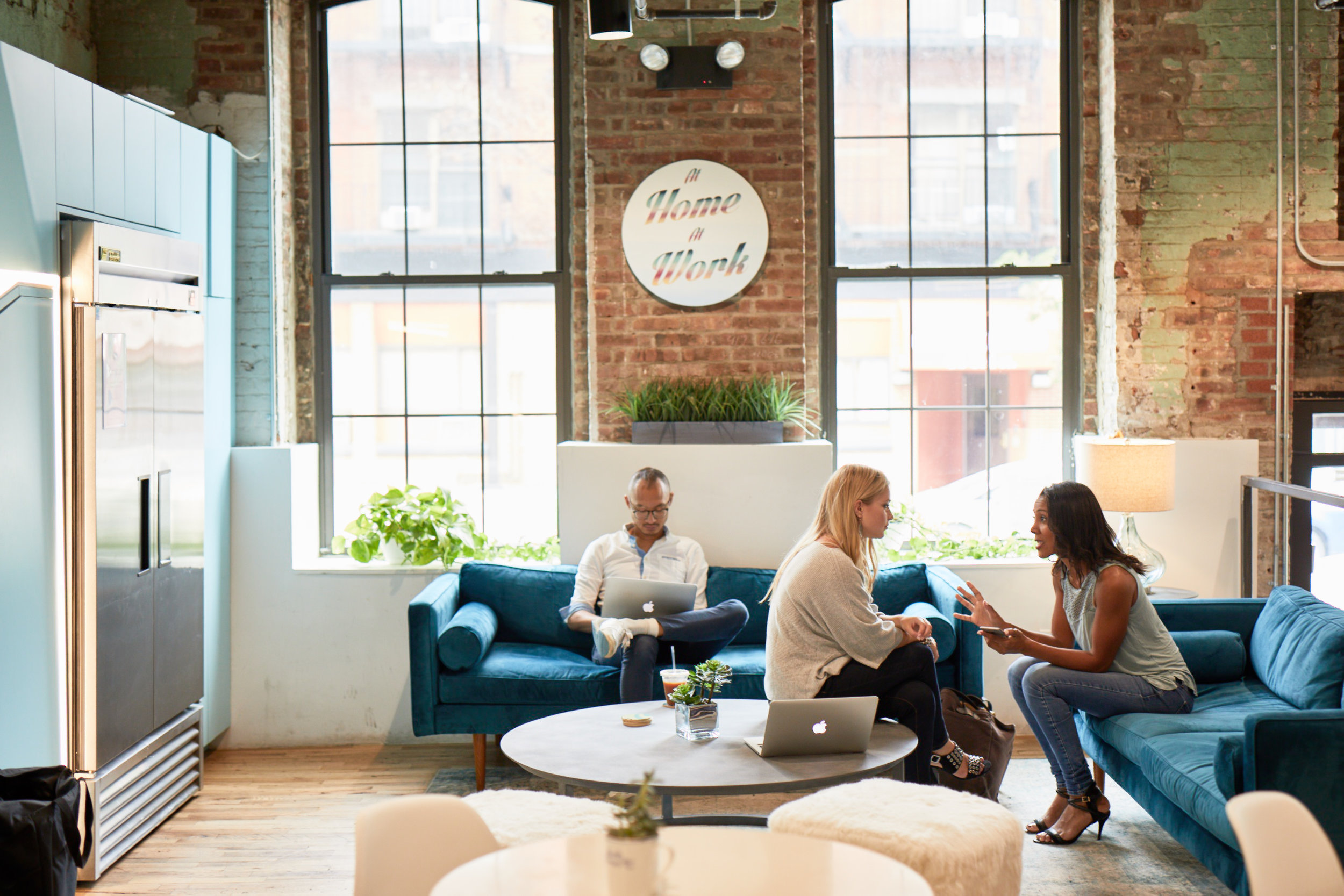 People chatting in the lounge area of a collaborative workspace