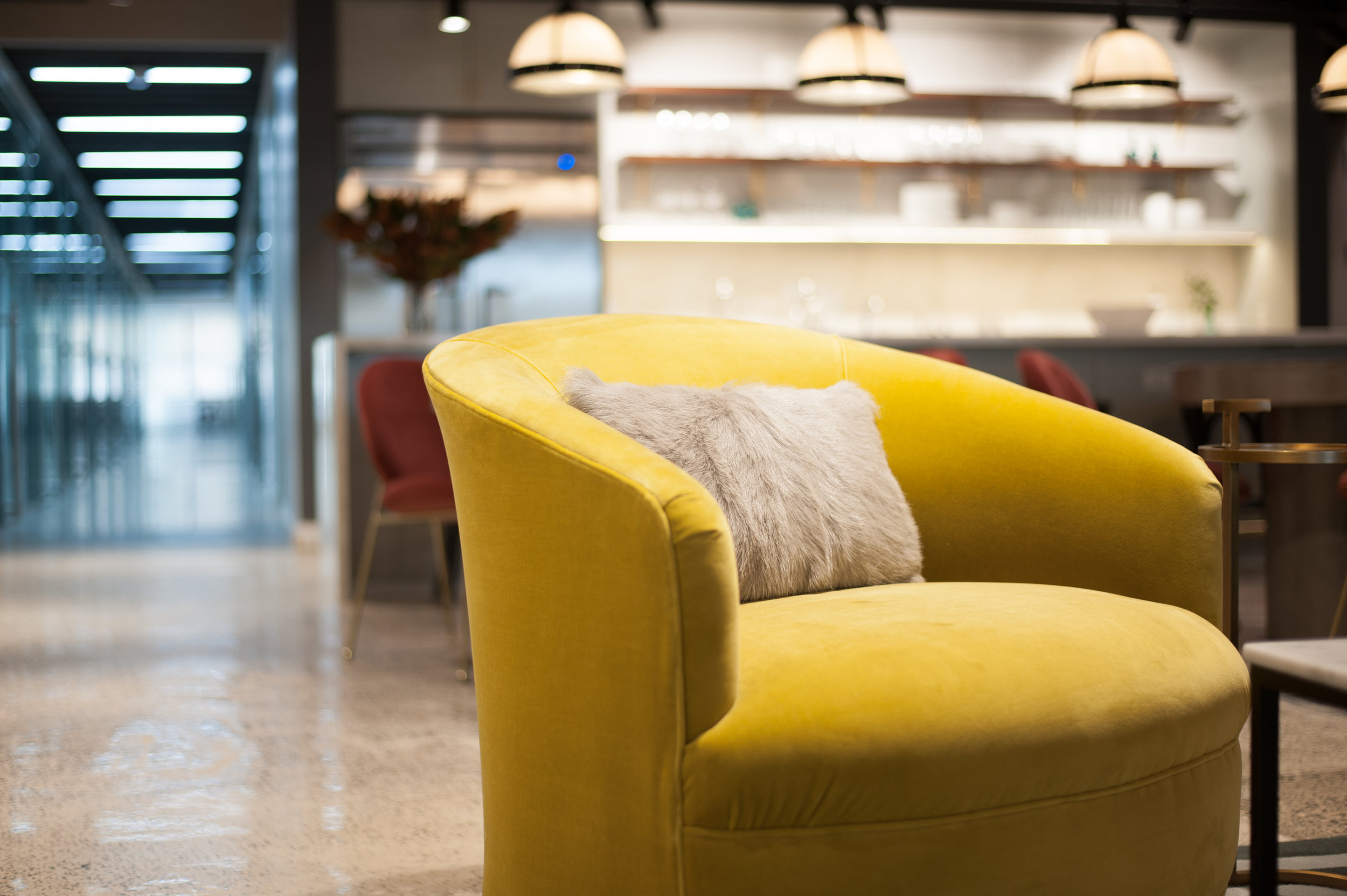 Yellow chair in a shared office space