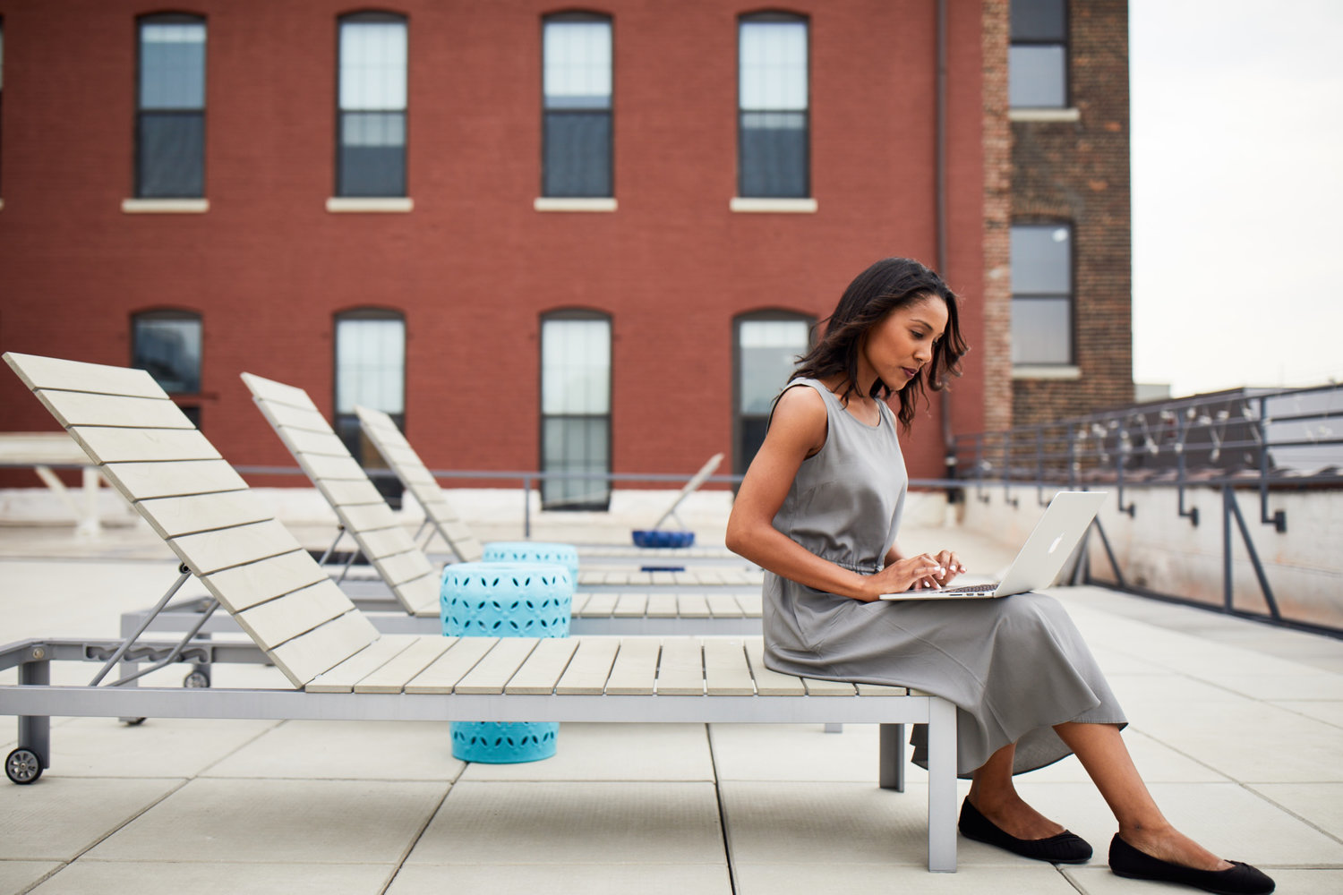 Woman working in an outdoor rooftop office environment