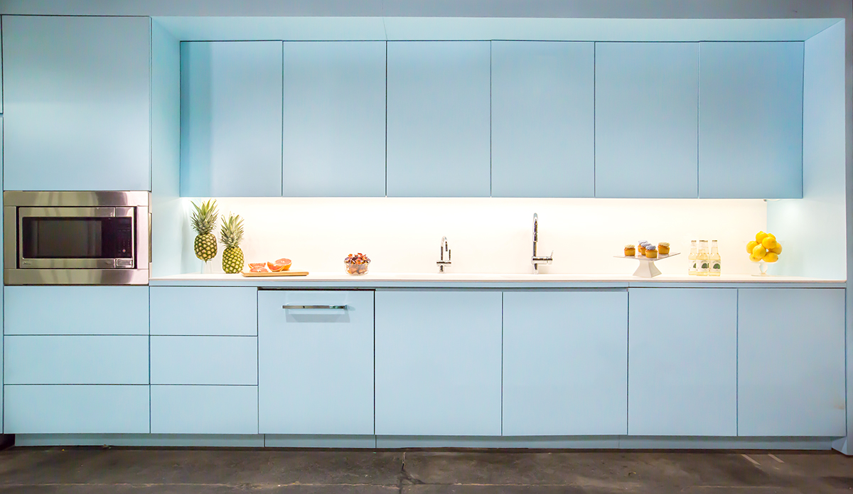 Blue kitchen cabinets in a modern office space