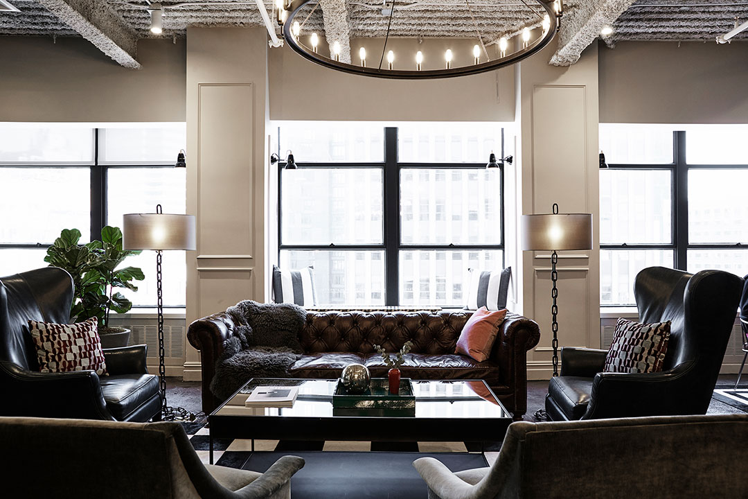 Professional-looking coworking space with leather sofas