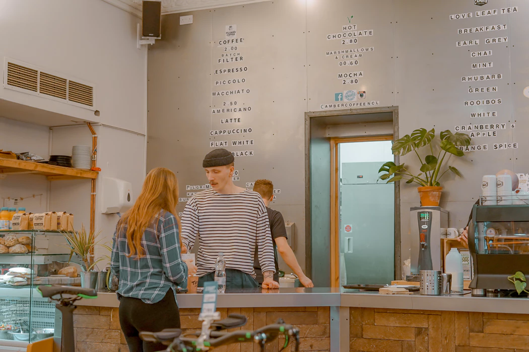 Customer and barista at a coffee shop