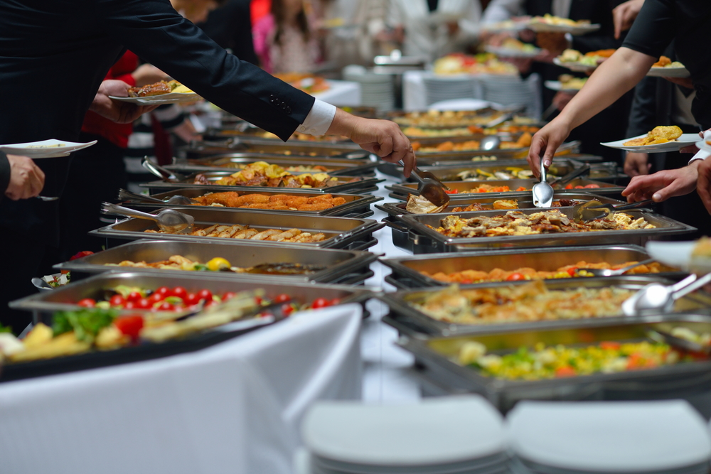 People filling their plates from a buffet