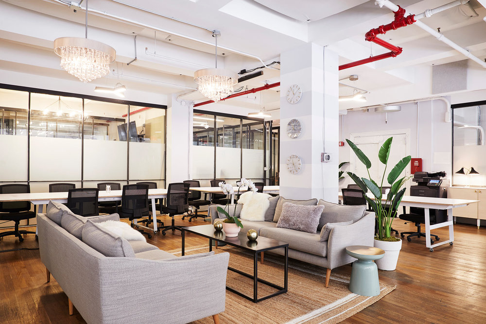 Lounge area with sofas in a shared office space