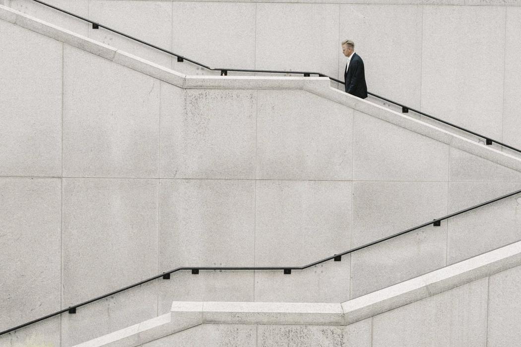 Business development professional walking up steps