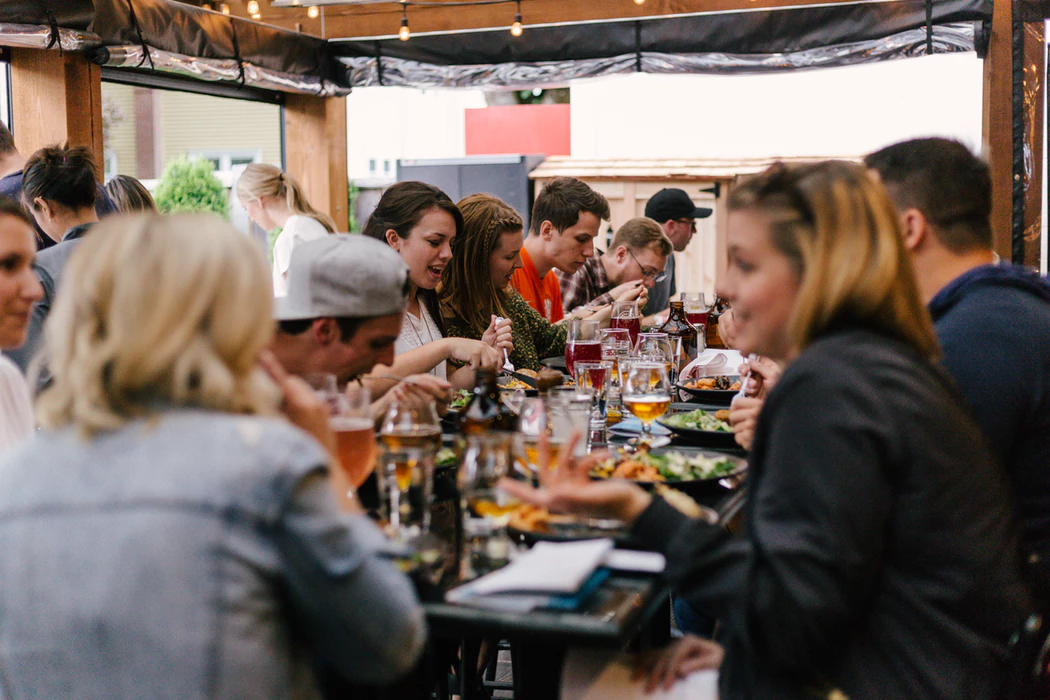 Employees eating together as a team-building activity