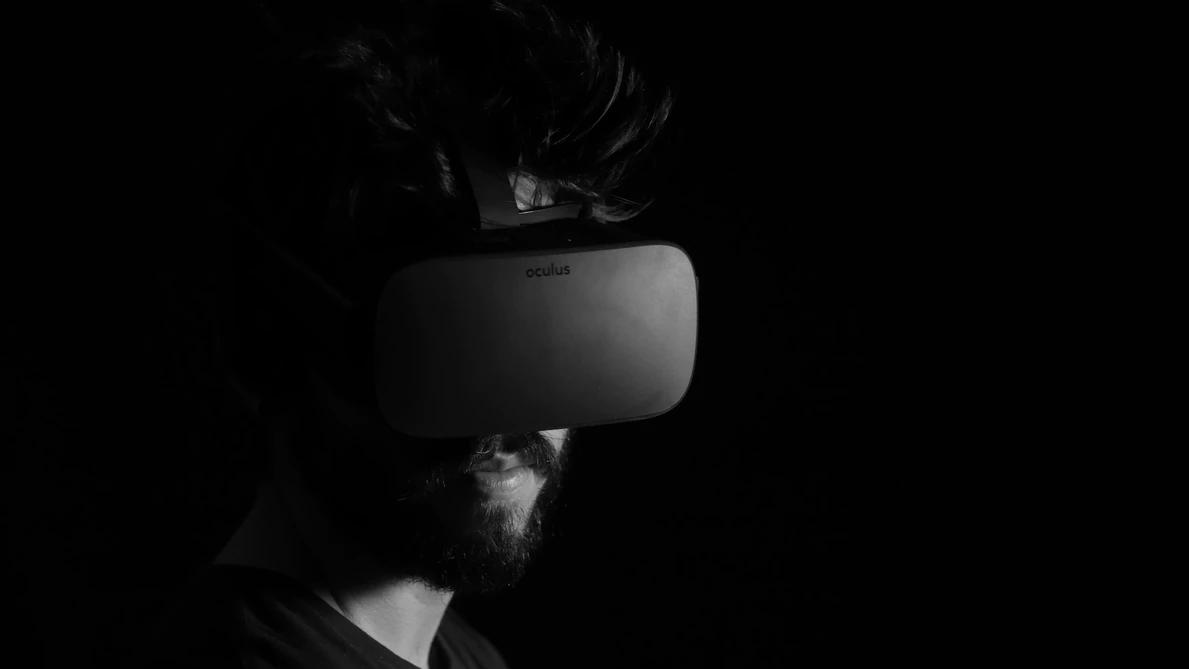 dark image of man wearing virtual reality headset