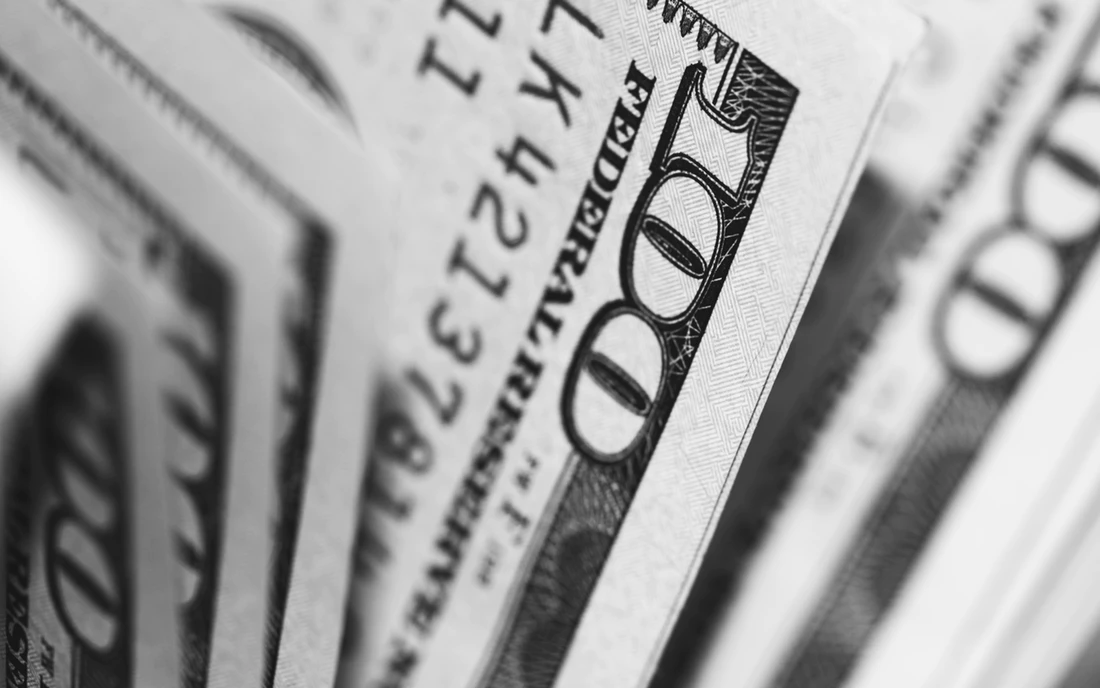 black and white close up of United States hundred dollar bills