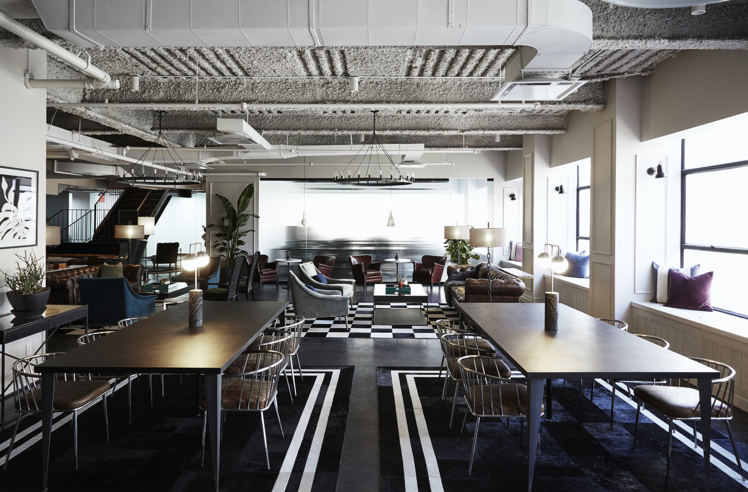 black and white office space with large tables and chairs