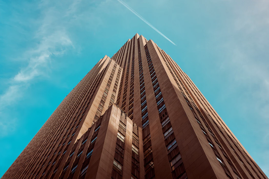 view looking upward at skyscraper on a clear day