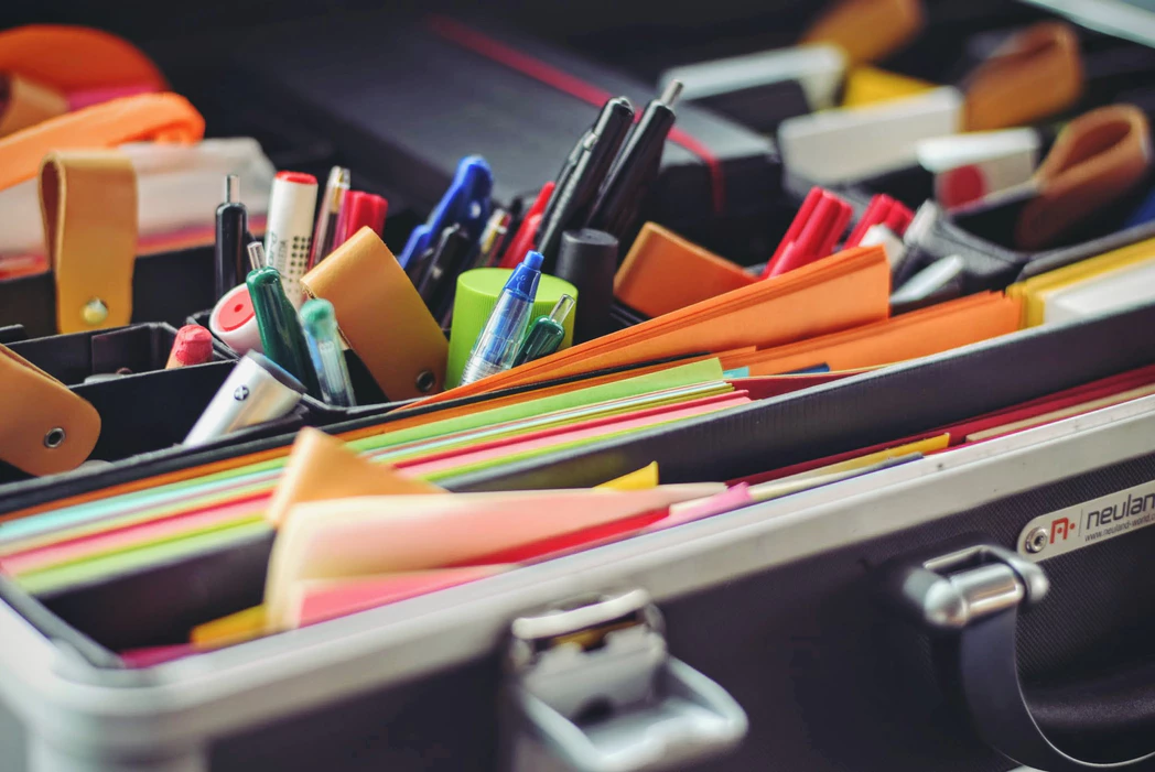 case of office supplies that can be shared amongst team members in an open office plan to reduce clutter