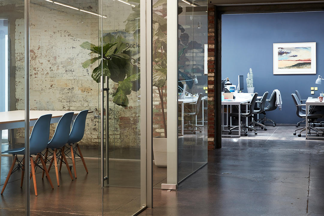 two functional working spaces within a shared office space