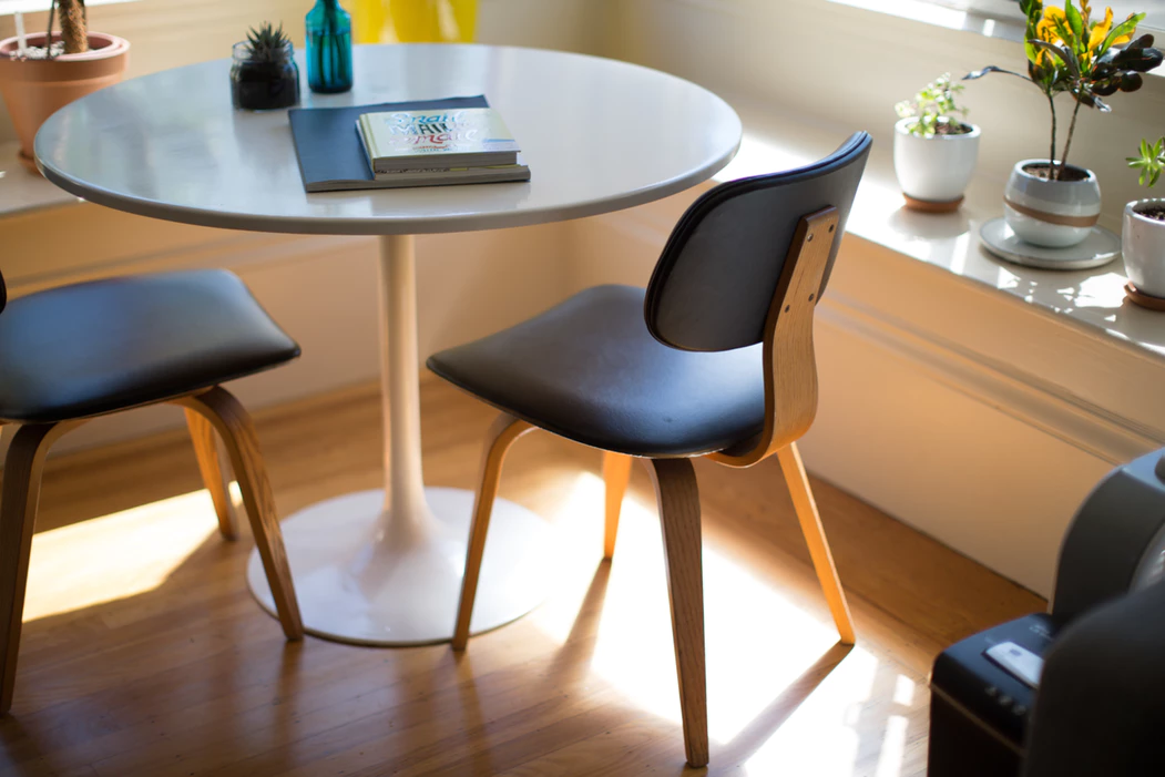 Small round table and two black chairs