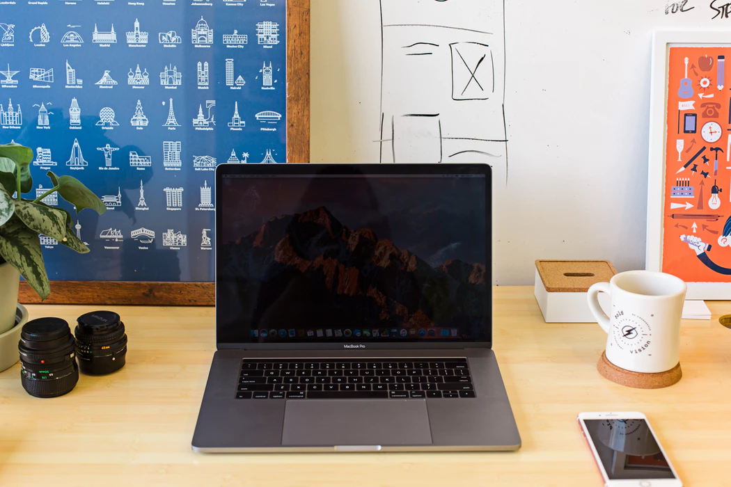 Clean desk with laptop, coffee mug, and plant