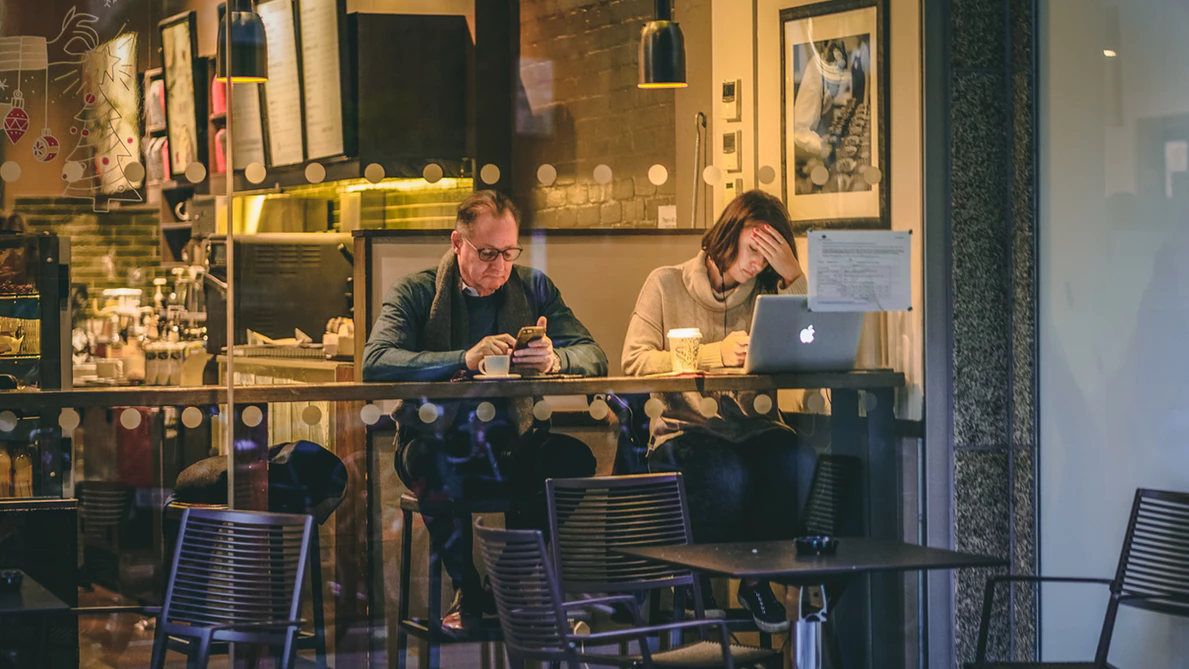 individuals doing remote work in a small cafe