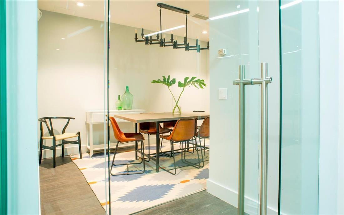 Conference room with glass doors and wooden table