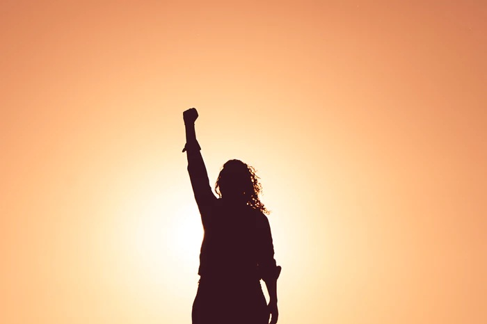 empowered team member with raised fist