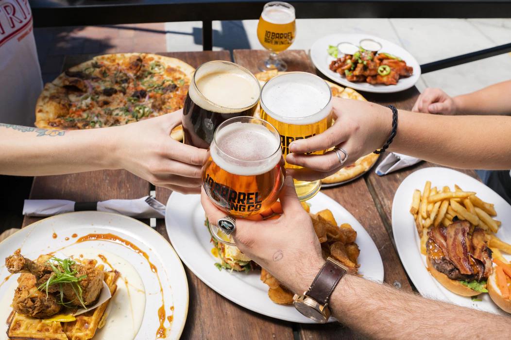 employees enjoying food and drinks