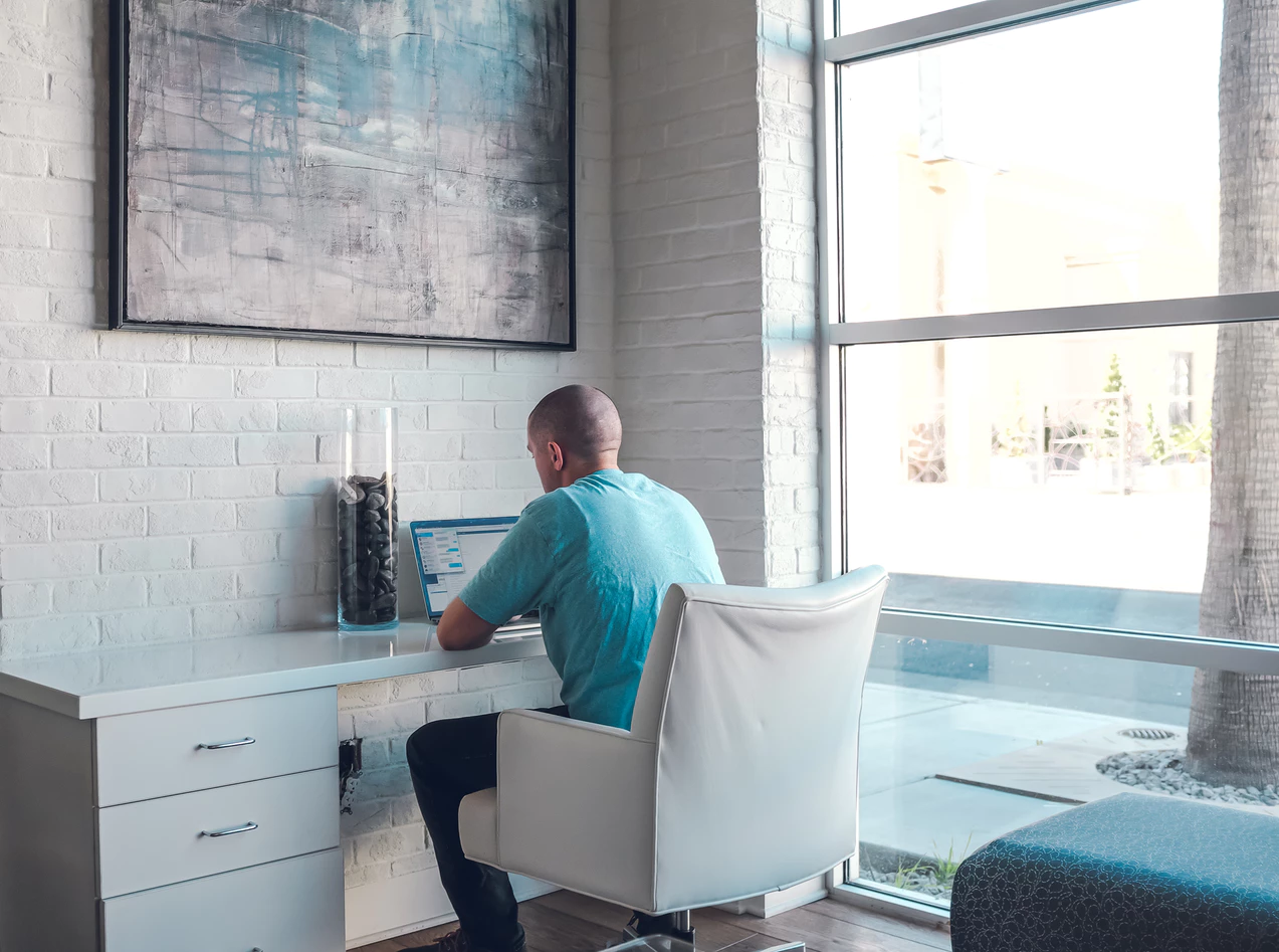 man using coworking space to remotely manage business