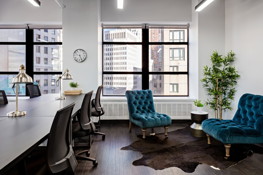 Coworking space with table and chairs as well as two accent chairs