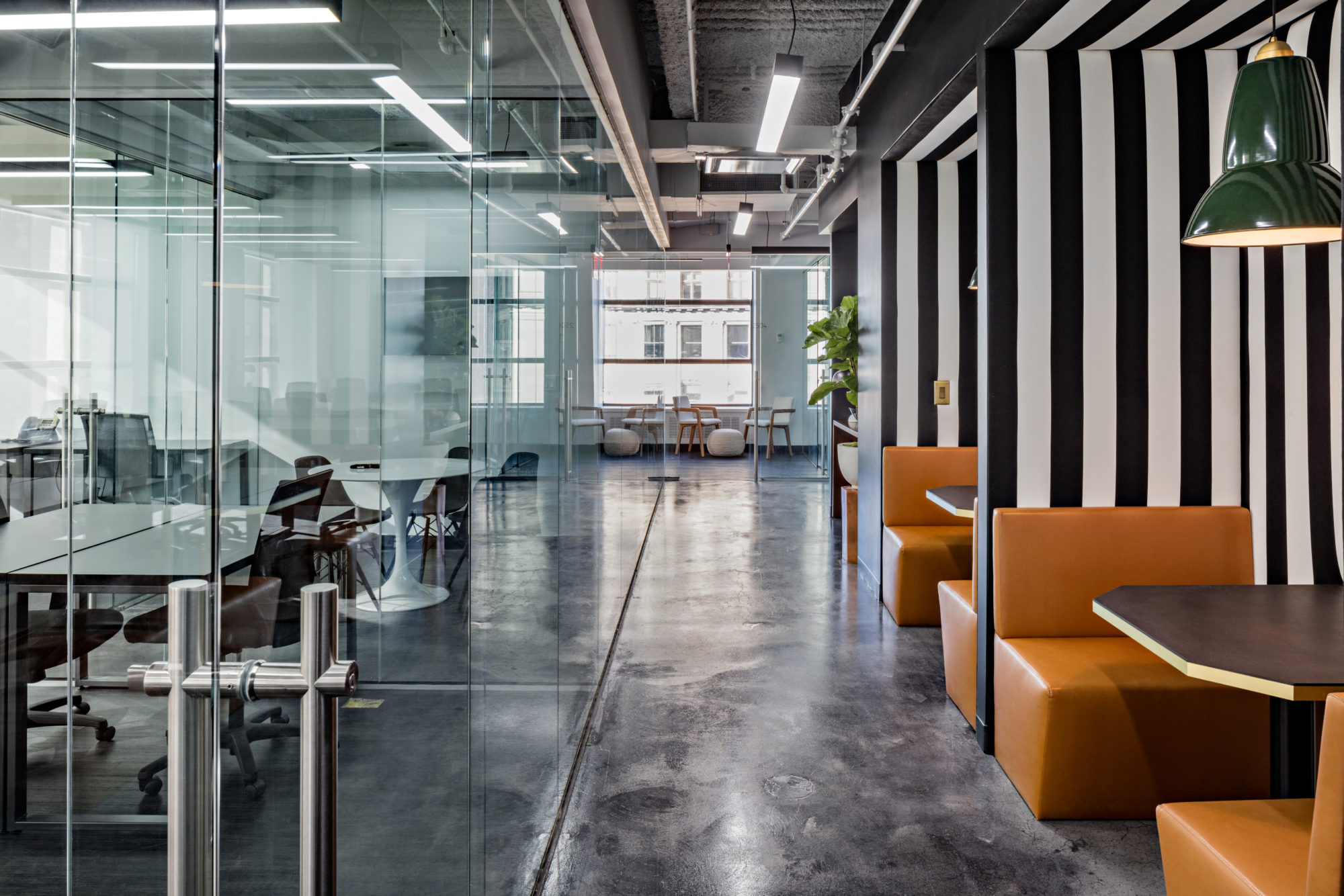 Open office layout with private desks and collaboration areas