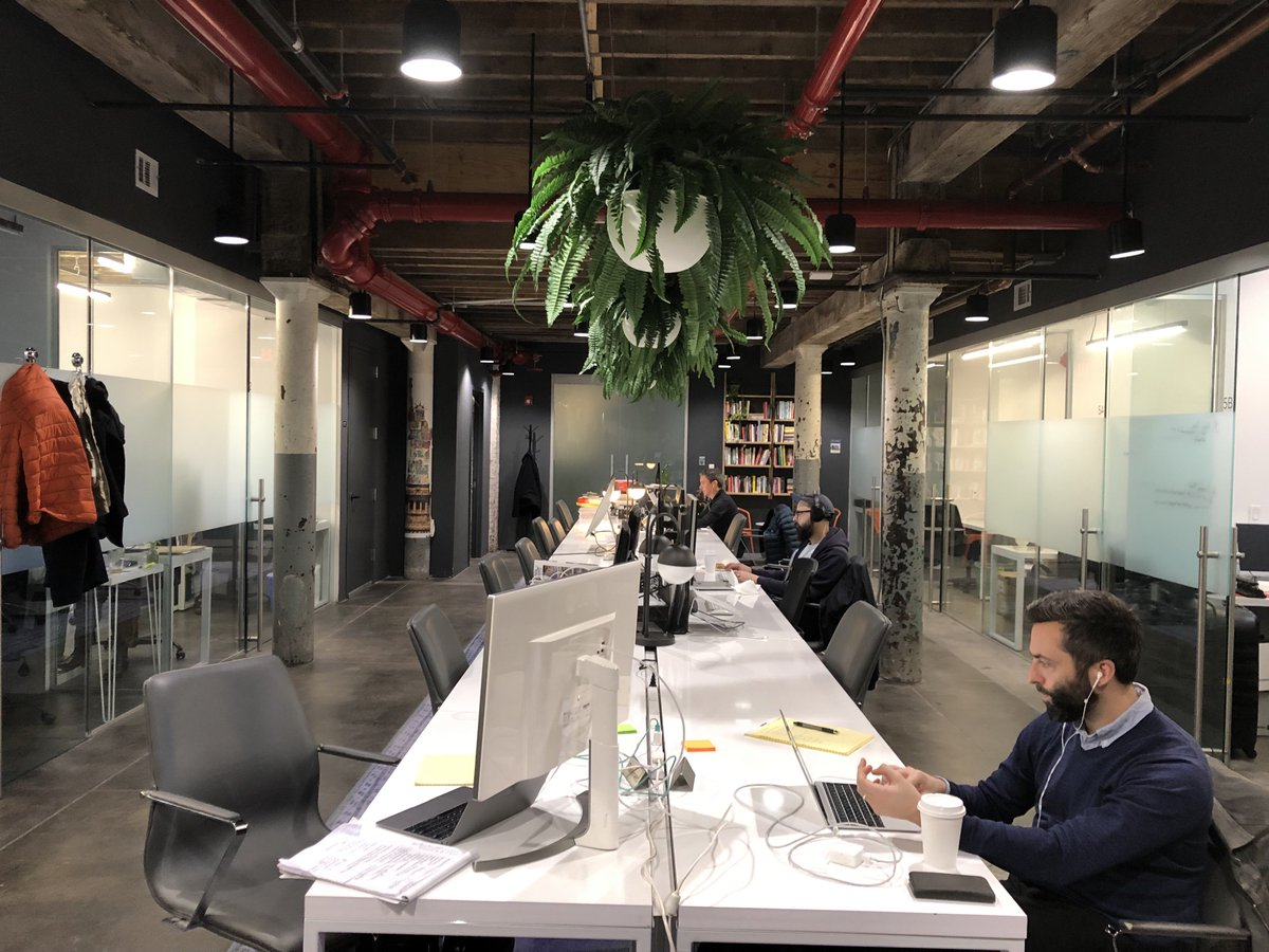 Three men working at a coworking space