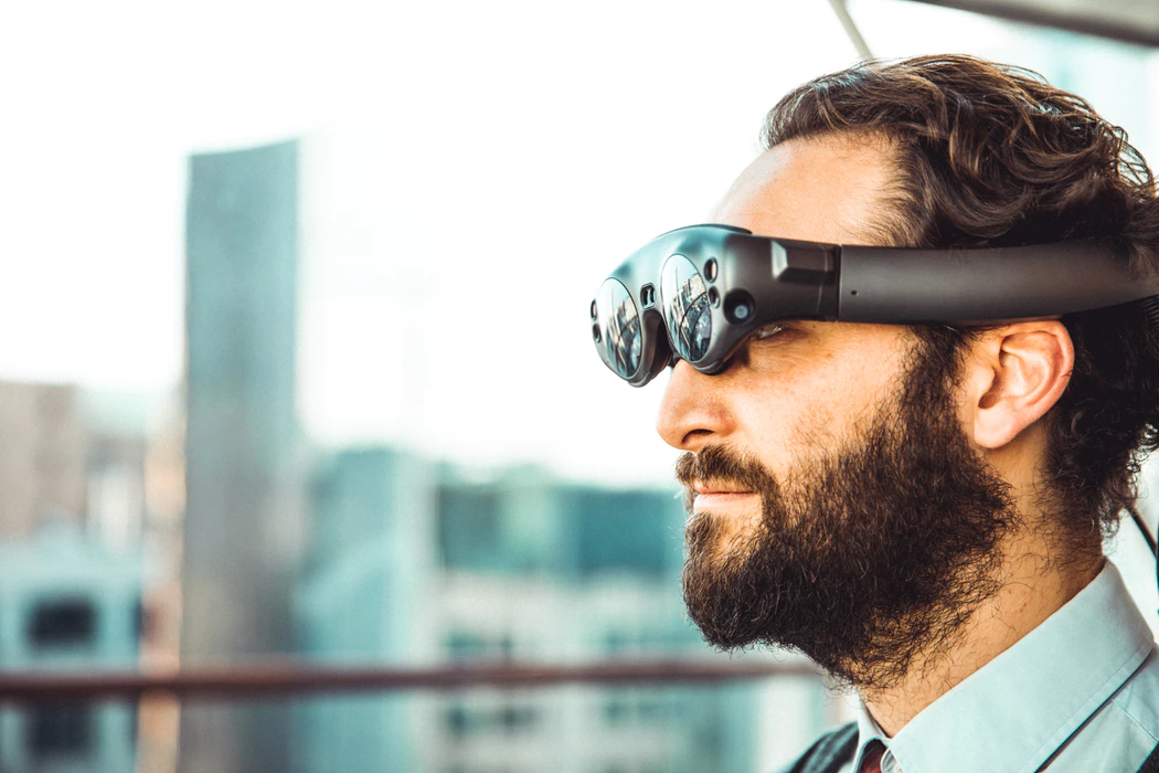 Man using technology in the workplace with virtual reality eye wear