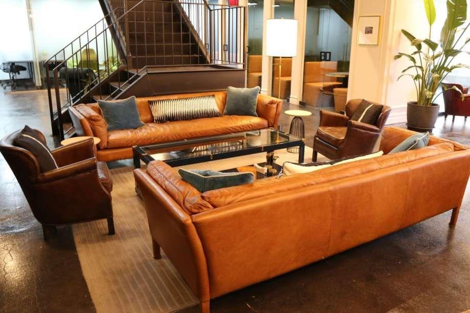Orange sofas in a lounge area